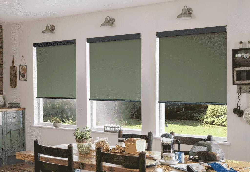 Green roller blinds in kitchen